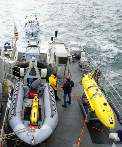 In the RHIB, A9-M AUV, next to A27-M AUV, followed by INSPECTOR USV with Seacans onboard.